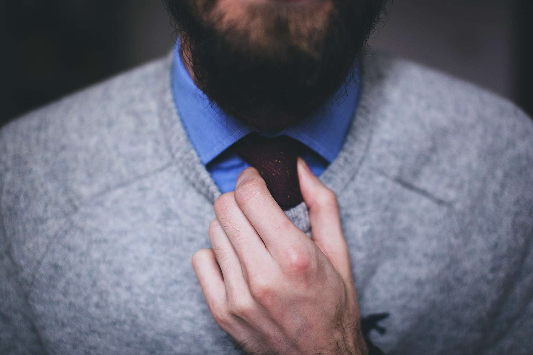 Man Adjusting Tie | Admissionado