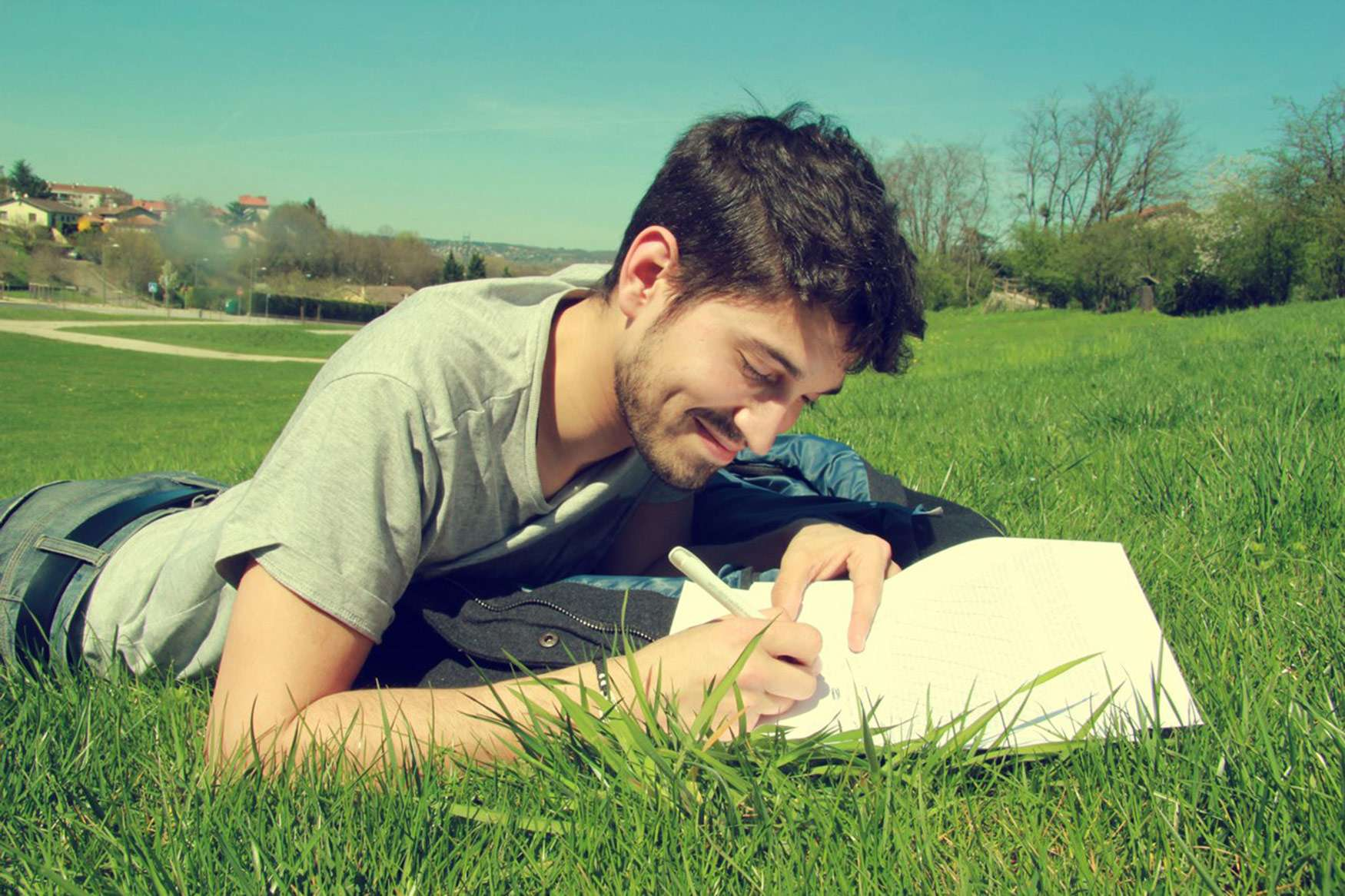 Student studying in grass